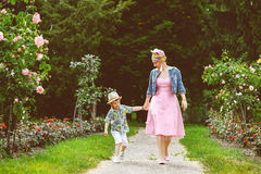 Happy Mother and son walking in summer park with Royalty Free Stock Images