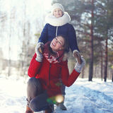 Happy mother and son walking in winter day Royalty Free Stock Photo