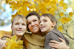 Happy Mother and sons. In the autumn park Royalty Free Stock Image