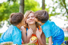 Happy mother with sons hugging Royalty Free Stock Images