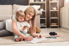 Happy mother spending time with her daughter. Happy mother spending time and playing with her cute daughter. Relationship, motherhood, trust, support, caress royalty free stock photo