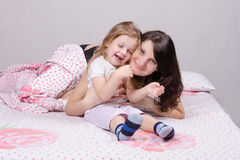 Happy mother and three year old daughter stock photography