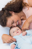 Happy mother tickling baby Royalty Free Stock Photography