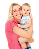 A happy mother tightly presses baby Royalty Free Stock Photography