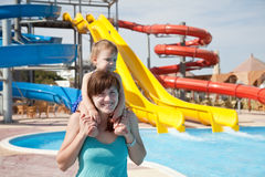 Happy mother with  toddler at aquapark Royalty Free Stock Photo