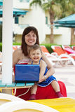 Happy mother and  toddler   with laptop Stock Images