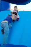Happy mother with  toddler on slide Royalty Free Stock Photo