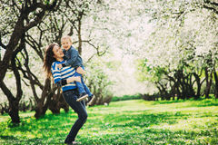 Happy mother and toddler son playing outdoor in spring or summer park Stock Image