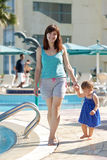 Happy mother with  toddler  walking  at resort Royalty Free Stock Images