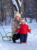 Happy mother with toddler   in winter Stock Photos