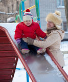 Happy mother with  toddler in winter Royalty Free Stock Photo
