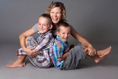 Happy mother with two boys Stock Photos