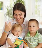Happy mother with two children Royalty Free Stock Images
