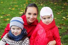 Happy mother and two children stock images
