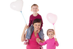 Happy mother and two children with balloons Royalty Free Stock Photos