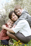 Happy mother and two children hugging Royalty Free Stock Photos