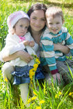 Happy mother and two children outdoor Stock Image