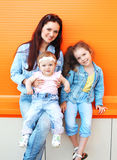 Happy mother and two children wearing a jeans clothes Royalty Free Stock Photography