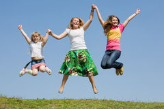 Happy Mother and two daughter jumping Royalty Free Stock Photo