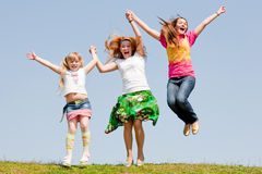 Happy Mother and two daughter jumping Stock Image