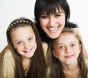 Happy mother with two daughters. Over white background Stock Image