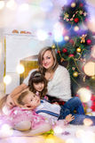 Happy mother and two her children in Christmas Royalty Free Stock Photos