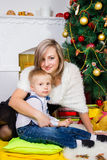 Happy mother and two her children in Christmas Royalty Free Stock Photo