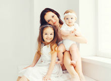 Happy mother with two her daughters children at home Royalty Free Stock Photography
