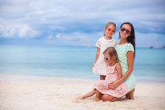 Happy mother and two her kids at exotic beach on. Happy mom and two her kids at exotic beach on sunny day Stock Images