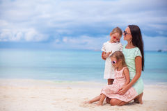 Happy mother and two her kids at exotic beach on. Happy mom and two her kids at exotic beach on sunny day Stock Image