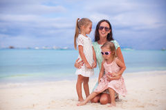 Happy mother and two her kids at exotic beach on. Happy mom and two her kids at exotic beach on sunny day Royalty Free Stock Images