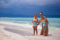 Happy mother and two her kids at exotic beach on. Happy mom and two her kids at exotic beach on sunny day Royalty Free Stock Photos
