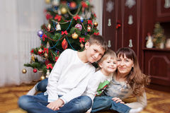 Happy mother and two her sons. Christmas photo Royalty Free Stock Images
