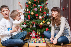Happy mother and two her sons. Christmas photo Stock Image