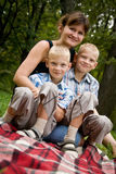 Happy mother with two identical twins Stock Photo