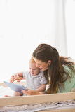 Happy mother using tablet with his baby boy Royalty Free Stock Images