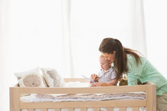 Happy mother using tablet with his baby boy Royalty Free Stock Photography