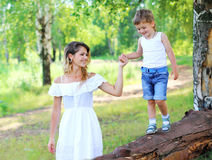 Happy mother walking with child son together outdoors in summer Royalty Free Stock Images