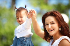 Happy mother walking with daughter Stock Image
