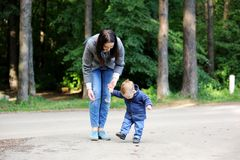 Happy mother walking with her son in the park Royalty Free Stock Images