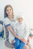 Happy mother and young child in the form of a chef Royalty Free Stock Photos