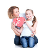 Happy mother and young daughter hold gift for birthday Royalty Free Stock Photography