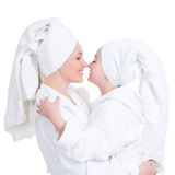 Happy mother and young daughter in white dressing gown Stock Image