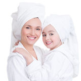 Happy mother and young daughter in white dressing gown Stock Photography