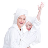 Happy mother and young daughter in white dressing gown Royalty Free Stock Photography