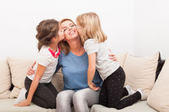 Happy mother with young daughters Stock Image