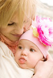 Happy motherhood. Beautiful young mother with her baby daughter in sling stock images