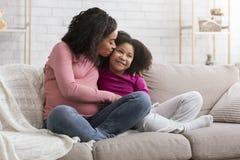 Free Happy Motherhood. Loving Pregnant Black Mom Kissing Little Daughter At Home Stock Image - 181715011