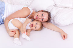 Happy motherhood in new home Stock Image