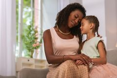 Pleasant caring mother being with her daughter royalty free stock photography